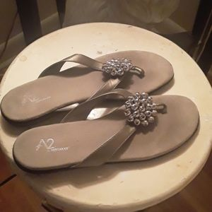 Brushed silver with balls decor.thong sandals
